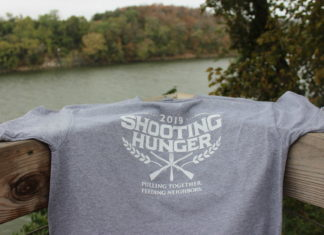 Shooting Hunger t-shirt against a river backdrop